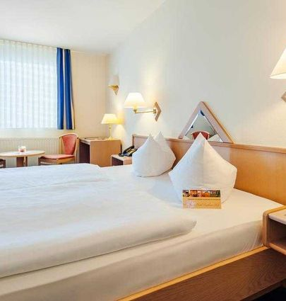 Hotel Rathener Hof.Doppelzimmer.hotels/91cf569f0df7c4428d41fcc9d1176402c80ceef9/room/hotel-rathener-hof-doppelzimmer-75808.jpg