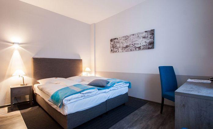 Hotel Alte Redaktion.Doppelzimmer.hotels/186ca838dcf6d35355654f260bf6521720530ab4/room/hotel-alte-redaktion-doppelzimmer-09683.jpg