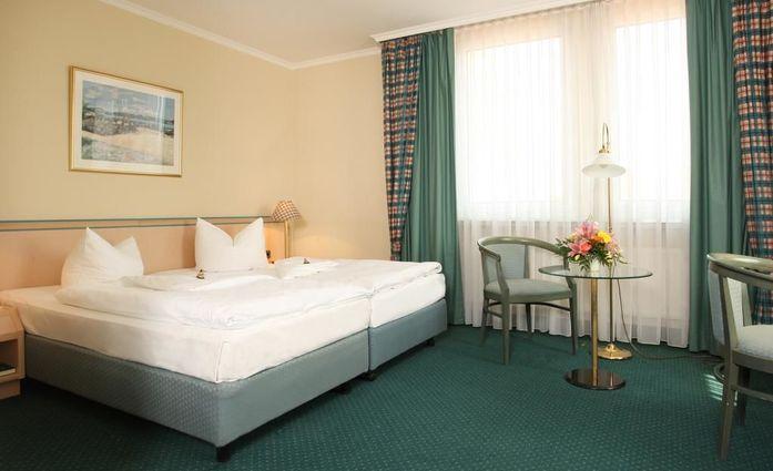 Europa Hotel Greifswald.Apartement.hotels/ad52863c58d59ae3d5e2be95141970711d48fd72/room/europa-hotel-greifswald-apartement-17808.jpg