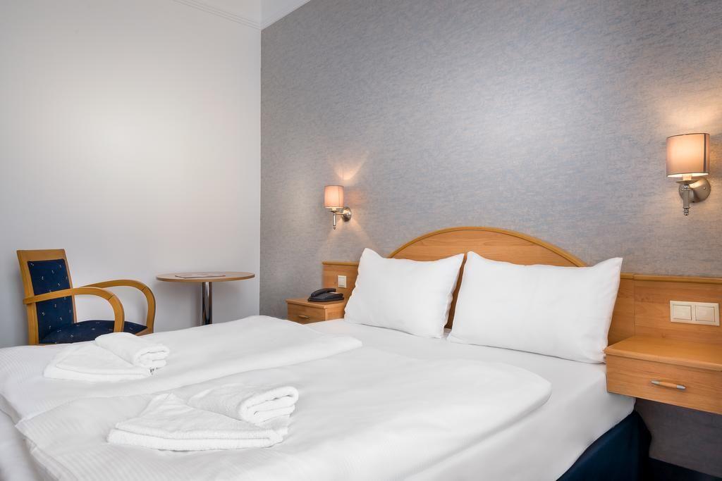 Novum Hotel Golden Park.Doppelzimmer.hotels/7305a6c803231214cde0d24a071d390de227f0cb/room/novum-hotel-golden-park-doppelzimmer-81313.jpg